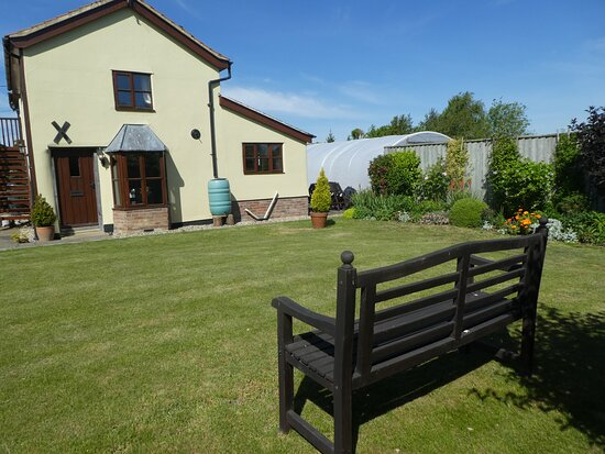 Garden and front door of holiday cottage