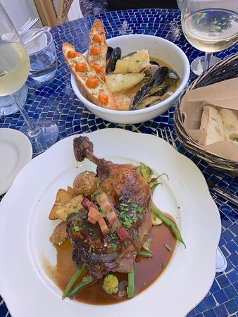 Bouillabaise and Coq au Vin, both beautifully prepared and presented, wonderful!