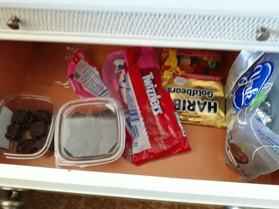 Housekeeping hadn't bothered to empty the nightstand drawers before releasing the room for occupation by subsequent guests.  I wonder just how long these candies had been in this drawer.