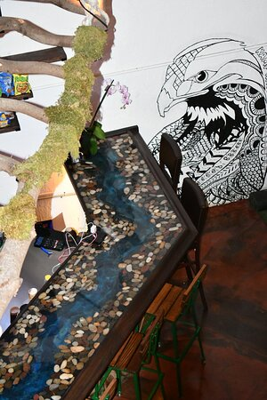 Arial view of the kava bar. One of a kind river rock, resin bar top.  Hand drawn eagle.   Handmade latter.