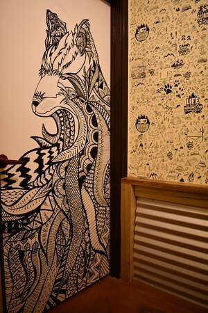 The wolf and camping caricatures on the walls are hand drawn!