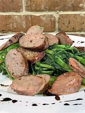 Broccoli Rabe with Sausage - Sautéed broccoli rabe and sausage with garlic and olive oil