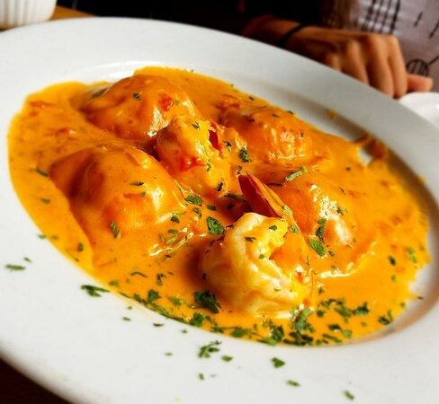 Ravioli Rosa - Lobster filled ravioli topped with shrimp in our delicious rose cream sauce