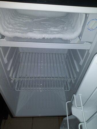 Room 405. Overgrown Ice in the Mini Refrigerator.