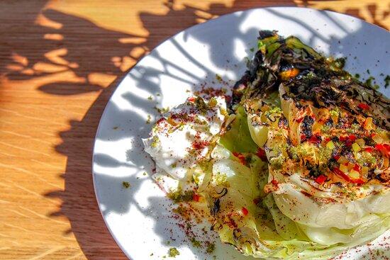 Hispi cabbage, soured cream, preserved lemon.