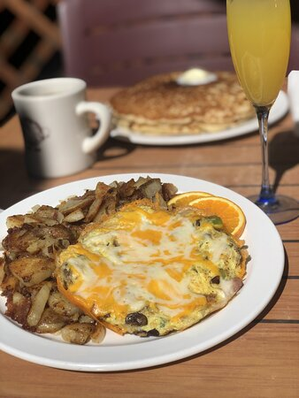 The Prospector is stuffed with bell peppers, onions, and mushrooms and smothered in melted cheddar cheese or jack cheese!  Our version of an omelette!