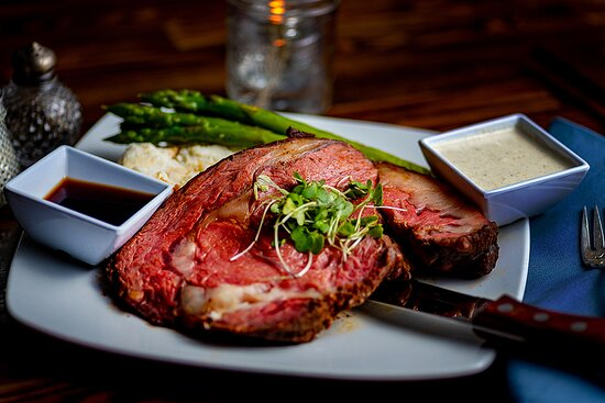 """Smoked Prime Rib with Garlic Mashed Potatoes, Sauteed Asparagus, Creamy Horseradish & Au Jus. . We're told over and over agian it's the best """"they've ever had""""! ***FRIDAY & SATURDAY ONLY!"""