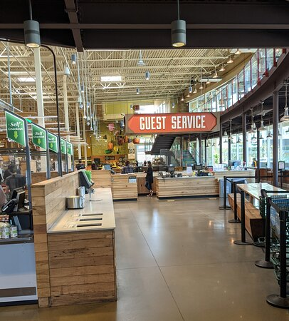 Guest Services by the entrance to  Whole Foods Market.