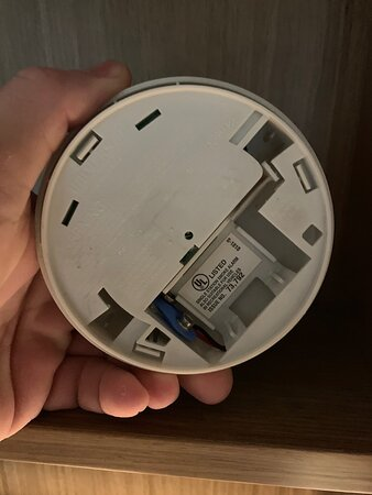 Smoke alarm on a shelf with no batteries
