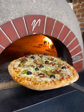 Stone-baked pizzas cooked in our wood-fired oven
