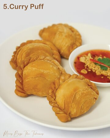 Deep fried minced chicken with onion and kumara in a puff pastry