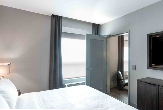 A spacious king size bedroom with a separate living area.
