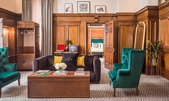 Heritage Suite Spacious separate lounge with wood panelling