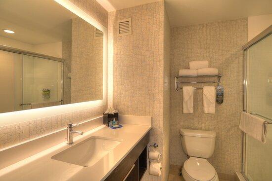 Guest Bathroom that has a walk in shower