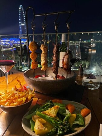 Main dish (mixed skewers, grilled veggies and chilly fries)