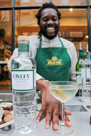 Our friendly and seriously skilled bartender Steve serves a classic gin martini.