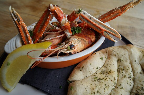 Langoustine alla Busara - our take on this traditional Venetian dish. We make ours with UK Langoustine (shelled), grilled and simmered in a rich tomato sauce. Served with homemade bread.