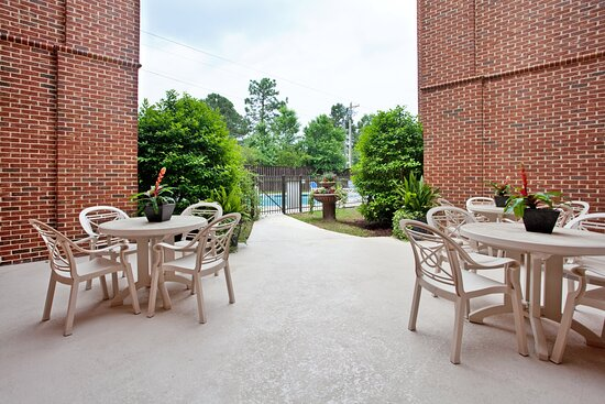 Our family friendly guest patio area to relax by our pool.