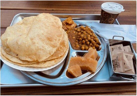 Mughal Nashta  Two puri served with a portion of achari Aloo, cholay, and halwa