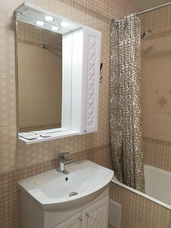 Просторная ванная комната с теплыми полами