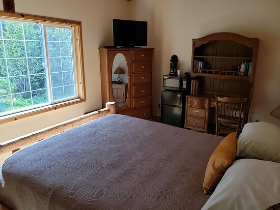 Heron, MT: Huck Fin room, with the curtain open. We actually left the window open.  It's upstairs and a beautiful view of the forest and  the spring.