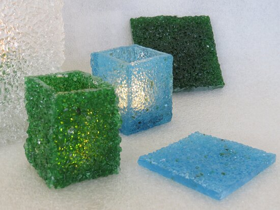 Crushed glass, fused into slabs and creating tea lamp holders