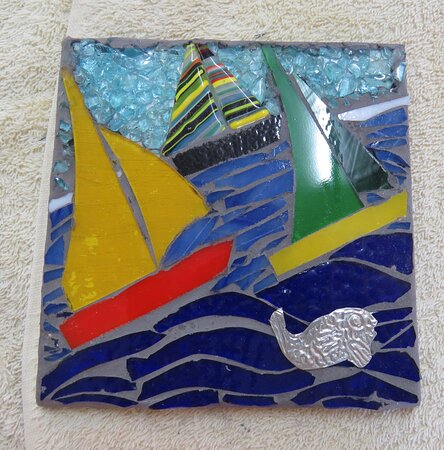 12 x 12 mosaic on wood. using cit off of glass.