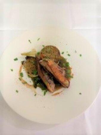 Filet de canette rôti, fenouil en croute d' herbes et jus aux olives