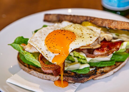 Club Sandwich Chicken, bacon, cos lettuce, mayo, Swiss cheese, avocado, egg.