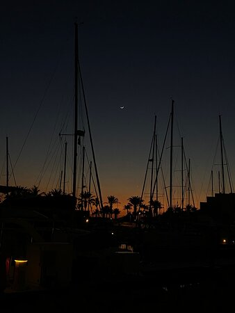 the moon in the evening at the Marina Costa Baja