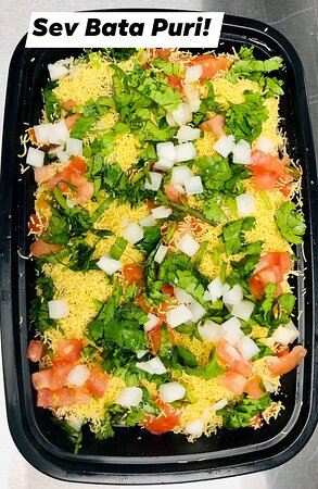 Sev Batata Puri - Crispy flat puri, sev boiled potatoes green chutney garlic chutney and tangy date tamarind chutney