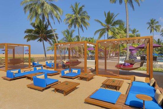 Exterior view of lounge seating areas and cabanas at Karadiya Bar