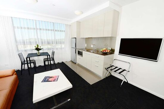 Interior view of lounge, dining area and kitchen in One Bedroom Executive Suite