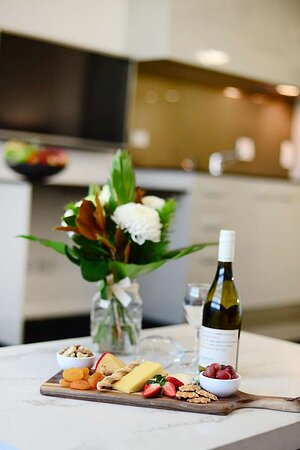 Detail of cheeseboard and wine with flowers in One Bedroom Suite