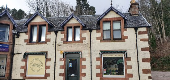 The Great Glen Gifts shop is on the bend , between nessieland and Loch ness exhibition centre