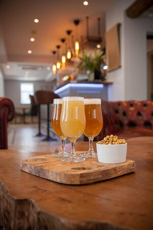 Try a beer flight, a selection of 3 beers served with nuts.