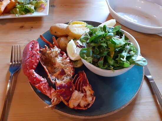 half lobster , garlic butter and new p[potatoes with a side salad