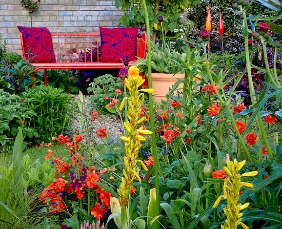 Relax among vibrant flowerbeds