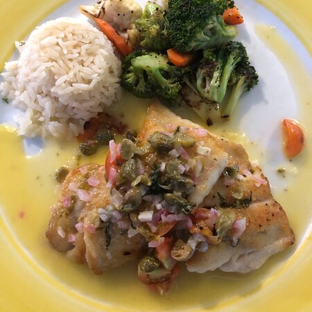 Catch of the day with white wine sauce, cherry tomatoes, capers, basil, rice and veggies