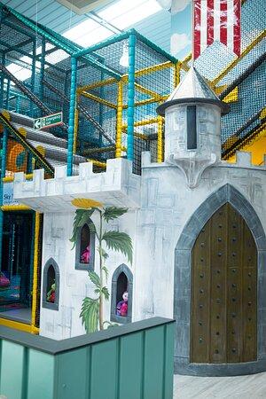 Explore inside the castle in the toddler playground.