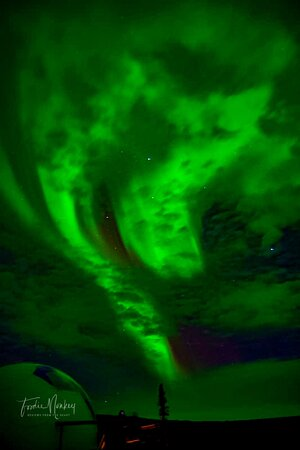 The Igloo with The Aurora  In The Background