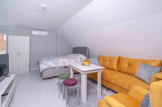 SATISFIED MOOD 303 The apartment is 1+0 living room with kitchen & bedroom. It's decorated with nice colors and furniture for you. You can enjoy your smart TV with Netflix or swim in the outside Pool. 24 hours hot water in Bathroom and in the Kitchen. There is one double bed in Bedroom and one Sofa bed in living room, which can sleep 2 person on it.We have washing machine and hair dry machine in our bathroom.