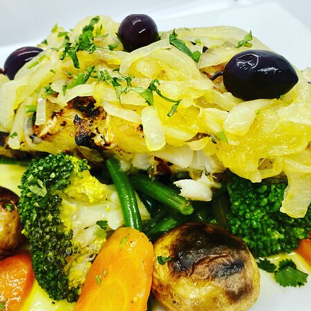 BACALHAU A LAGAREIRO grilled cod loin served with roast ºpunchedº potatoes and vegetables, drizzled with garlic, onions and olive oil