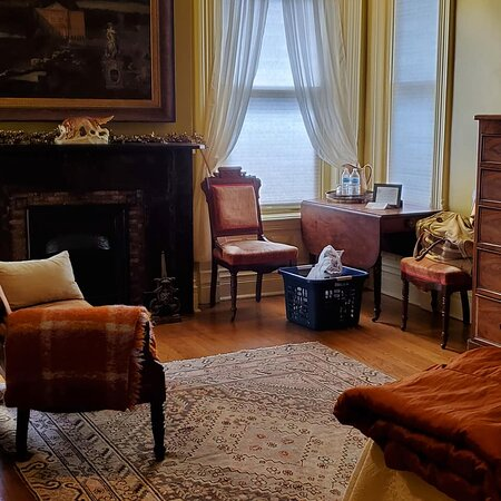 Twelfth Night Room, features a king bed,  4-jetted shower, fireplace and stained glass windows.