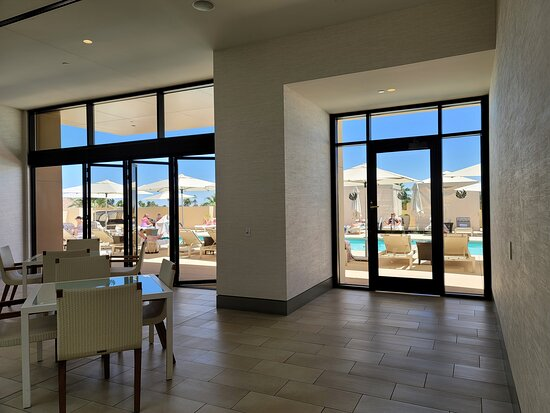 Indoor dining area near rooftop pool.