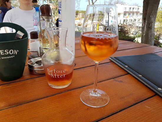 A jug of rosé wine of the house