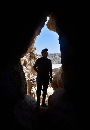 Exploring a cool little cave in the desert.