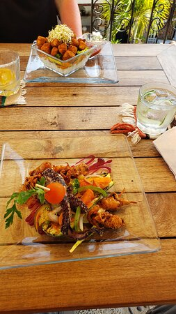 Crispy Tofu w/ veggies and rice   Octopus and Calamari in  a zucchini boat