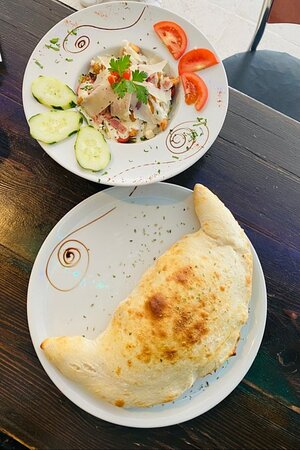 Chicken Ceaser Salad also with Calzone Calaprese Pizza only at in Choice Restaurant.