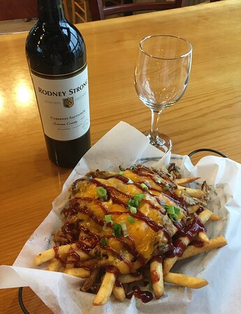 Pork Fries - house-roasted pulled pork over seasoned fries, melted cheese & a robust BBQ sauce